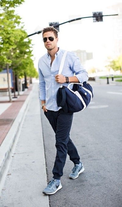 a blue shirt, navy joggers, blue and navy trainers, a navy sport bag for a comfy fall outfit