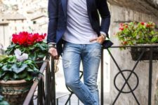 a casual chic look with blue ripped jeans, a grey tee, a navy blazer and colorful navy and red trainers