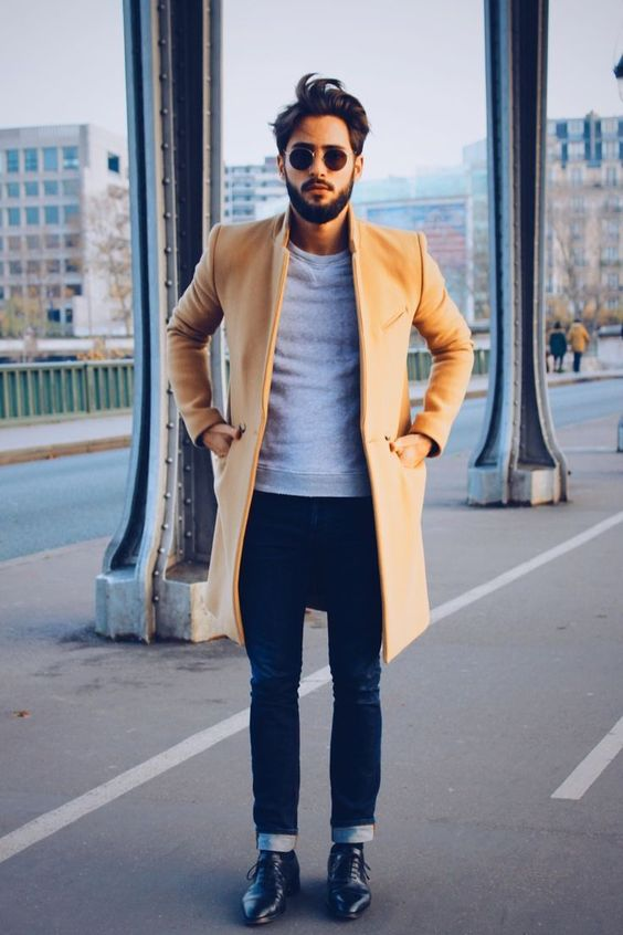 a grey tee, navy jeans, a camel coat and black shoes - you don't need more to look good