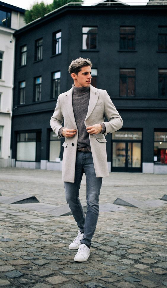 a grey turtleneck, blue jeans, white sneakers, a neutral short coat for a chic fall or winter look