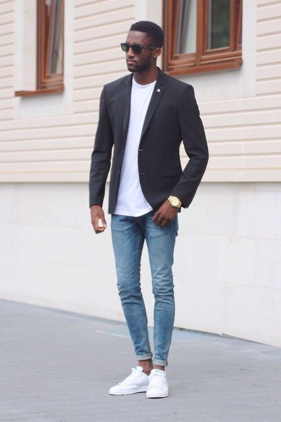 a minimalist look with a white tee, a black blazer, bleached jeans, white sneakers for the fall