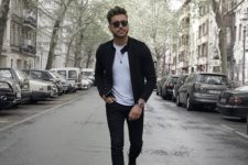 a monochromatic fall look with a white tee, black jeans, a black leather jacket and black trainers