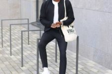 a navy bomber jacket, navy pants, a white tee, white sneakers and a tote for a laconic fall look