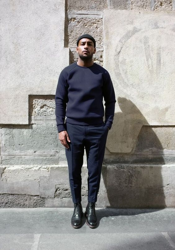 a navy sweatshirt, navy pants, black shoes and a black hat for a chilly fall day