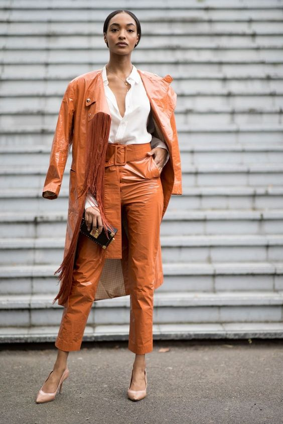 a rust colroed lacquered leather trench and matching cropped pants, a white shirt and nude heels
