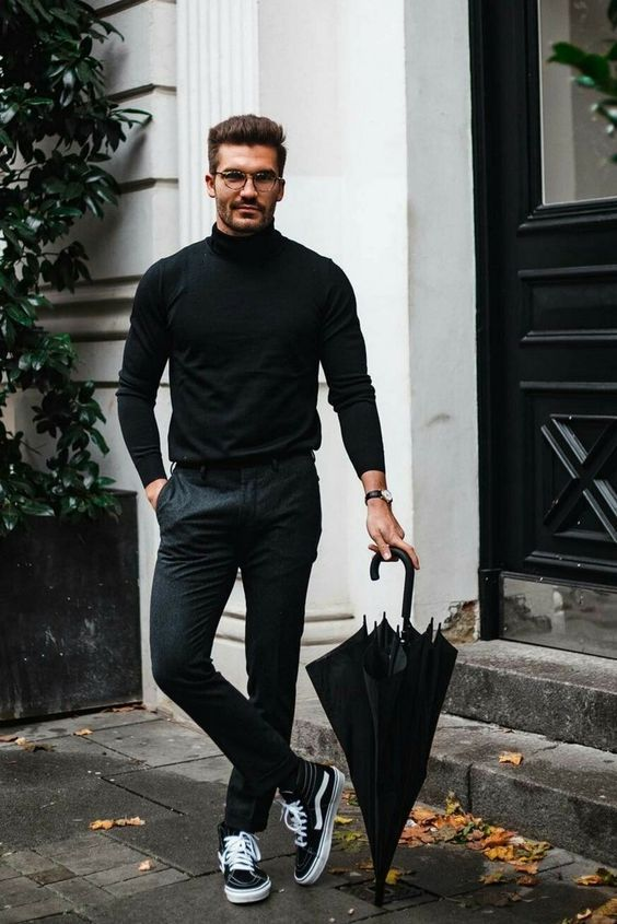 a simple minimalist look with a black turtleneck, grey pants, black sneakers and glasses