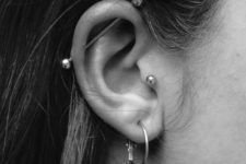 a stylish look with three piercings – a lobe, a tragus and an industrial one, all done with similar accessories