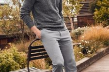 a stylish minimalist fall outfit with a grey jumper, grey cropped pants and white sneakers