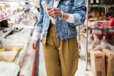 a white long sleeve top, a blue denim jacket, mustard-colored oversized pants, white sneakers for the fall