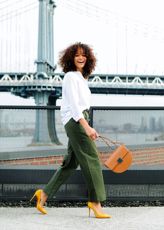 a white shirt, green oversized wideleg pants, yellow shoes and a camel bag for an outfit in fall colors