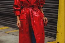 blue jeans with a raw hem, a white turtleneck, metallic red shoes and a red lacquer trench for a bit of edge