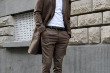 brown pants, a white tee, a printed brown blazer, burgundy shoes and a matching hat for a cold day