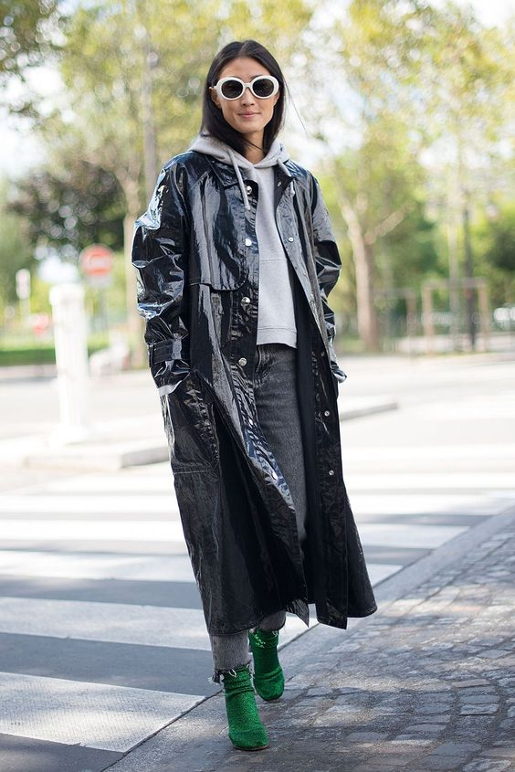 grey jeans with a raw hem, a grey hoodie, emerald booties and a black lacquer midi trench for the fall