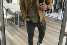 grey joggers, an olive green t-shirt, a camel moto jacket, grey and black trainers for a comfy sporty look