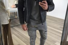 grey ripped jeans, a grey tee, a black leather jacket, black trainers for a chic monochromatic look
