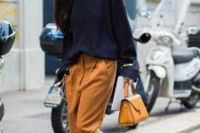 oversized camel pants, a navy jumpser, two tone shoes and a bold small bag for a bit of edge
