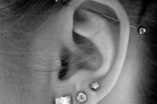 three lobe piercings paired with a single horizontal industrial one make your ear outstanding