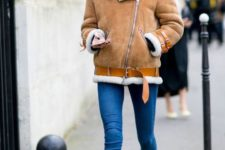 a winter look with an aviator coat and combat boots