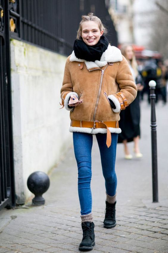 a casual outfit with blue skinnies, a black scarf, an amber and white aviator coat and black combat boots