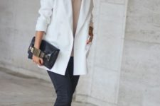 02 a neutral top, black straight jeans, white boots, a white oversized blazer and a black bag