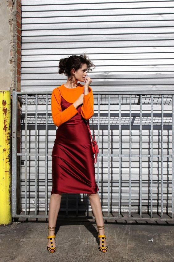 an orange jumper, a burgundy silk knee slip dress, bold shoes for a trendy and colorful fall outfit