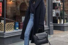 03 a black turtleneck, blue cropped jeans, white sneakers, an oversized midnight blue coat and a black bag