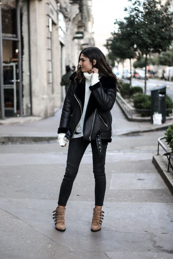 a casual outfit with a white sweater, black skinnies, brown belted booties and a black aviator coat