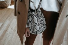 03 a chic fall look with rust pants, a white oversized sweater, white shoes and a camel coat plus a snake bag