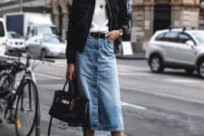 03 a chic fall outfit with a white tee, a blue denim midi skirt with buttons, a blakc belt, black boots and a black bomber jacket