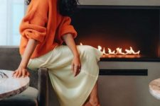 03 a neutral silk midi, an orange oversized sweater and tan suede pumps for a chic and refined look