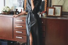 04 a black leather midi dress on buttons with a belt and black shoes to go to the office