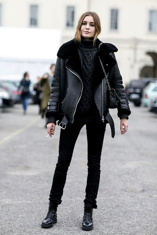 a casual winter look with a grey sweater, a black aviator coat, black jeans and black combat boots