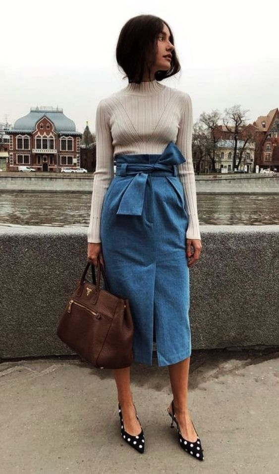 a creative and girlish look with a neutral turtleneck, a blue denim pencil midi skirt, polka dot shoes and a brown bag