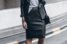 04 a grey t-shirt, a black leather knee skirt, a black leather shirt, black combat boots and a bag