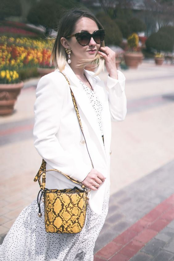 a lovely yellow bucket snake leather bag will add a touch of color to your outfit and make it edgy