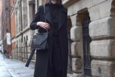 04 a midi black wrap coat with a classic collar is a stylish and trendy outer garment piece to wear with any outfit