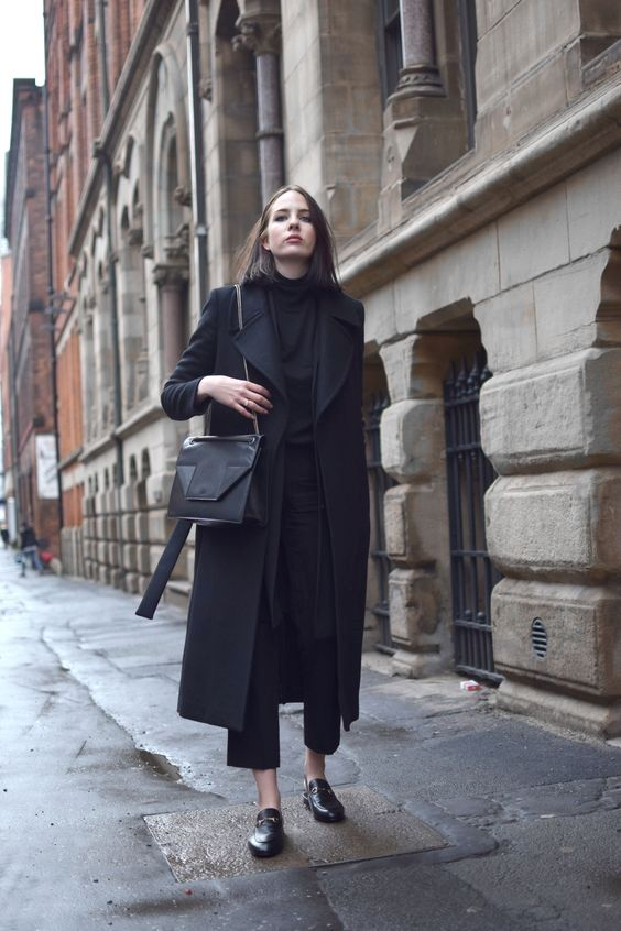 a midi black wrap coat with a classic collar is a stylish and trendy outer garment piece to wear with any outfit