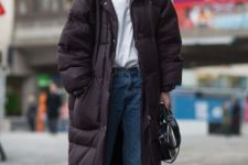 04 a relaxed outfit with blue jeans, a white tee, white sneakers and an oversized black padded coat