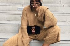 04 a tan knit suit with culottes and a sweater, white trainers and a belt bag for a comfy winter look