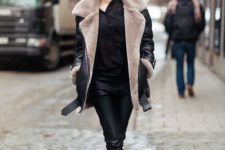 05 a chic look with a black shirt, black leather pants, black booties and a black and taupe aviator coat