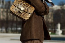 05 a classic box bag of snake print leather in such a natural color combines trends and timeless designs