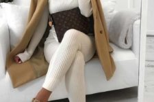 05 a white knit suit wit pants, a turtleneck top, a camel coat and camel sneakers plus a brown clutch