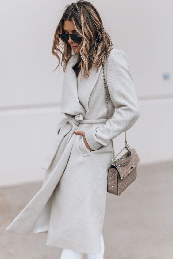 a woolen off white wrap coat will give you a super chic look and a refined feel with its color and silhouette