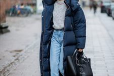 05 an elegant look with a grey jumper, blue jeans, emerald velvet heels and an oversized navy padded coat
