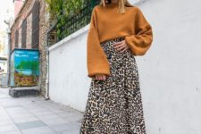 05 an elegant look with a mustard sweater, a leopard print midi skirt, a mustard beret and black boots