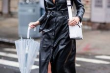 06 a black leather maxi dress on buttons and with a belt, brown shoes and a white bag for the fall