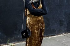 06 a chic party look with a black turtleneck, a gold velvet midi slip dress, red boots and a black bag