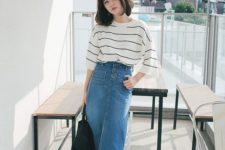 06 a gorgeous relaxed look with a striped top with long sleeves, a blue denim midi skirt with a slit, black sneakers and a tote