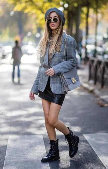 a nude turtleneck, a black leather mini skirt, black combat boots, a grey plaid blazer and a grey bag