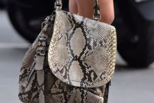 06 a snake leather backpack will add a chic and bold touch to the outfit and will provide much stuff